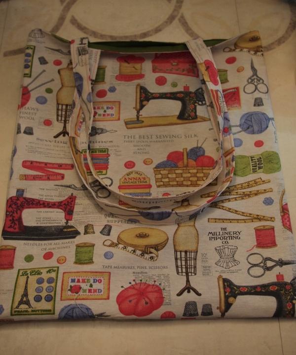 Reversible shopping tote, in sewing/haberdashery print, laying flat